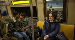 Comedian and writer Maeve Higgins rides the A subway train in New York: the honesty of the book is powerful and impressive. Photograph: Michael Nagle
