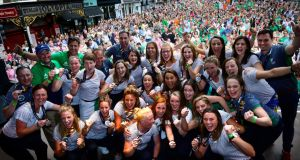 The Irish hockey team pictured on stage on Dame Street follwing their reception at City Hall. Photograph: Cyril Byrne/THE IRISH TIMES