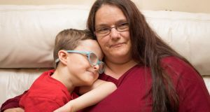 "Christina Laurence and her  son Luke. ""He gets sick very quickly, but doesn't have any nursing support,"" she says. Photograph: Tom Honan"