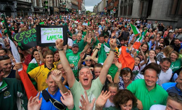 HOCKEYING FOR POSITION: Hockey fans celebrate amid a homecoming party for the Irish Hockey team on Dame Street, Dublin, after their silver medal placing in the Hockey World Cup in London. Photograph: Gareth Chaney/Collins
