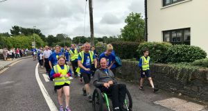 Fr Tony Coote arrives into Ballydehob having finished his arduous trek which he undertook over the course of the last month. Photograph: Jonathan Healy