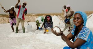 Marie Diouf, aka Queen of Salt, displays some of the pure salt which her team of workers are harvesting at Fatick plains in Senegal. Photograph: Lar Boland