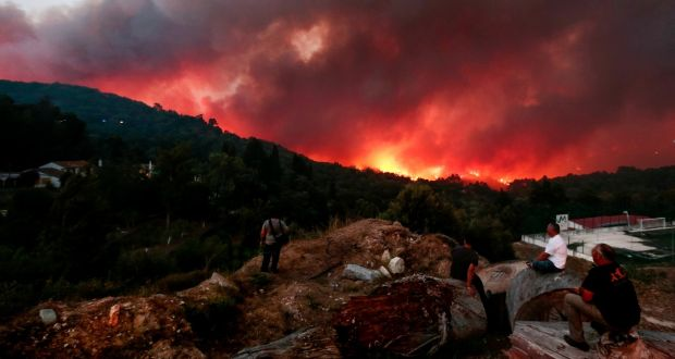 People observe a forest fire in Brejo village, Monchique, Faro south of Portugal on Monday. Photograph: Filipe Farinha/EPA