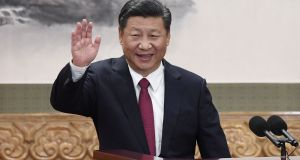 Chinese president Xi Jinping waving at the Great Hall of the People in Beijing.