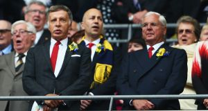 Arsenal's majority shareholder Stan Kroenke (L) has made an offer to take full ownership of the club. Photograph: Paul Gilham/Getty
