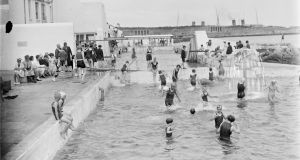 People bathe at the public baths at Dún Laoghaire, circa 1925. Photograph: Dillon Family/National Library of Ireland Flickr Commons