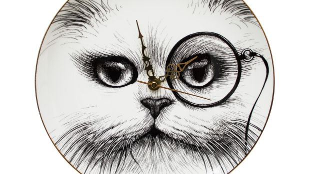 Monocle cat clock