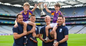Ryan O'Dwyer, Bill O'Carroll, Fergal Whitely and Niall Corcoran, with U- 10 Kilmacud Crokes hurlers Michael Lyng, left, and Cian Manning at the launch of the The Beacon Hospital/Kilmacud Crokes  All-Ireland Hurling Sevens at Croke Park. Photograph:  Ramsey Cardy/Sportsfile