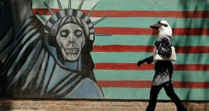 Mural on the wall of the former US embassy in the Iranian capital Tehran: Ireland has yet to exploit an economic relationship of scale. Photograph: Atta Kenare/AFP/Getty Images