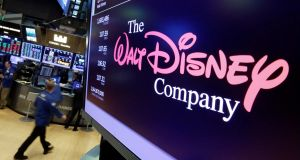 The Walt Disney Co logo on a screen above the floor of the New York Stock Exchange. Total revenue rose 7 per cent to $15.23 billion, but missed analysts' expectation of $15.34 billion. Photograph: Richard Drew/AP