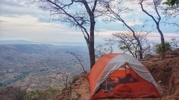 The couple camped along the route, like here in Malawi. Photograph: Simplycycling.org via The New York Times
