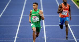 Ireland's Leon Reid on his way to finishing second in the men's 200m final at the European Athletics Championships. Photo: Morgan Treacy/Inpho