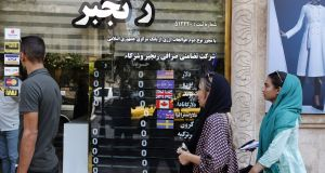 People outside  a currency exchange shop in the Iranian capital Tehran. US president Donald Trump has warned the world  against doing business with Iran. Photograph:  Getty Images