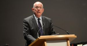 Minister for Justice Charlie Flanagan set out a new system under which asylum seekers apply to the Department of Justice for work permits. Photograph: Dara Mac Dónaill