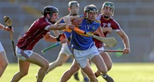 Tipperary's Colin English gets past Sean Loftus of Galway during their under-21 All-Ireland semi-final encounter. Photo: Laszlo Geczo/Inpho