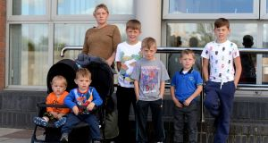 Margaret Cash with her children Johnny, Thomas, Michael, Andy, Jim and Miley outside the Council Offices in Tallaght. Photograph: Cyril Byrne/The Irish Times.