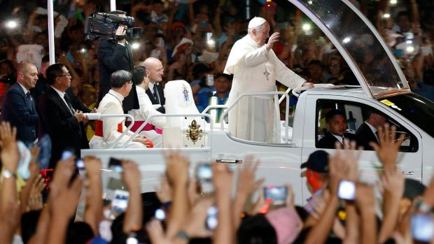 Pope Francis on a Popemobile waves to Filipino well wishers in 2015. Photograph: Francis R Malasig/EPA