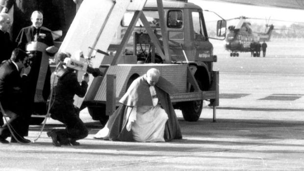 Pope John Paul II arrives into Dublin Airport on Saturday, 29th September, 1979 and kneels to kiss the ground. Photograph: The Irish Times.