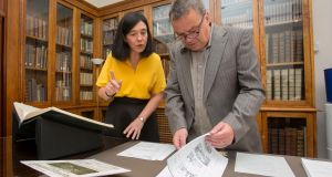Neil Jordan and Director of the NLI, Dr Sandra Collins, with material from the donation at The National Library of Ireland (NLI). Photograph: Gareth Chaney Collins