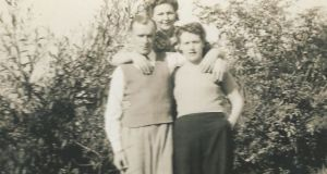 """Mam and Dad and Mam's sister in their garden."""