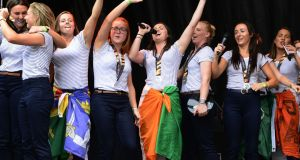 The Irish hockey team dancing on stage on Dame Street following their reception at City Hall. Photograph: Cyril Byrne