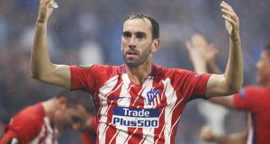 Diego Godin has been linked with Manchester United but is said to be happy at Atletico Madrid. Photo: Getty Images