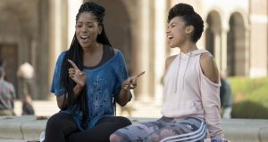 Ashley Blaine Featherson and Logan Browning in the US Netflix comedy 'Dear White People', which explores the dynamics of modern race relations. Photograph: Eddy Chen/Netflix