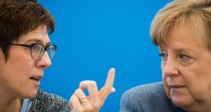 CDU party secretary general Annegret Kramp-Karrenbauer speaks with  chancellor and leader of the party Angela Merkel. Photograph: Odd Andersen/AFP/Getty Images