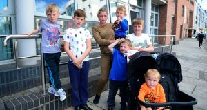 Margaret Cash with her children Johnny, Thomas, Michael, Andy, Jim and Miley, who spent Wednesday night sleeping in Tallaght Garda station. Photograph: Cyril Byrne