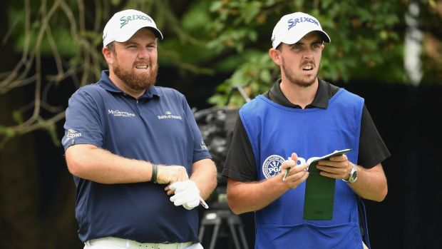 Shane Lowry with his brother Alan on the 18th tee. Photo: Ross Kinnaird/Getty Images