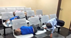 Children asleep on metal chairs in Tallaght Garda station on the night of August 8th after they and their mother were forced to sleep there due to lack of emergency accommodation. Photograph: PA Wire
