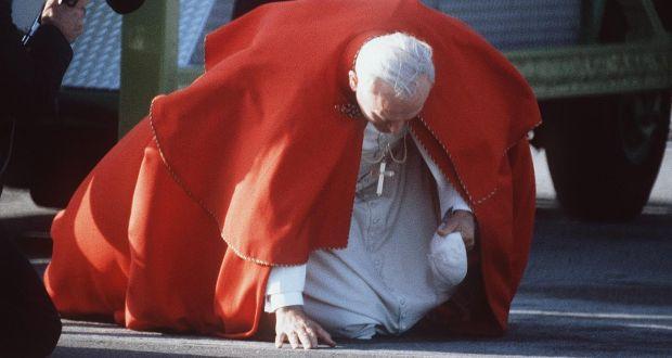 pope john paul ii kisses thr ground on arrival in dublin 1979 photograph