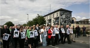 Family members of those shot dead and wounded on Bloody Sunday in June 2010, making  their way from the Bogside to the Guild Hall ahead of the publication of the Bloody Sunday inquiry report in Derry. Photographer: Dara Mac Dónaill