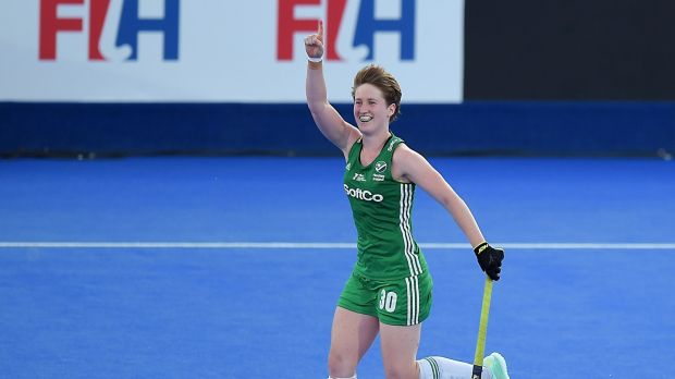 Ireland's Ali Meeke celebrates her shootout goal against India in the quarter-finals of the World Cup. Photograph: Joe Toth/Inpho