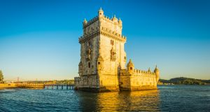 Torre de Belem tower overlooks the  river Tagus in Lisbon. Photograph:  Stock image