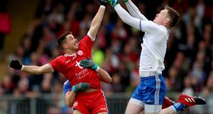 Tyrone's Ronan O'Neill with Ryan Wylie and goalkeeper Rory Beggan of Monaghan in the Ulster SFC  quarter-final at Healy Park in May. Photograph: James Crombie/Inpho