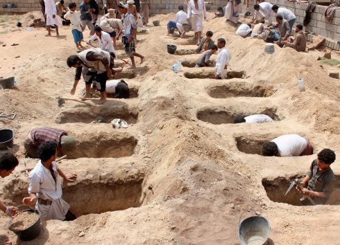 DARK DAY: Yemenis dig graves for children, who where killed when their bus was hit during a Saudi-led coalition air strike, that targeted the Dahyan market the previous day in the Houthi rebels' stronghold province of Saada. Photograph: AFP/Getty Images