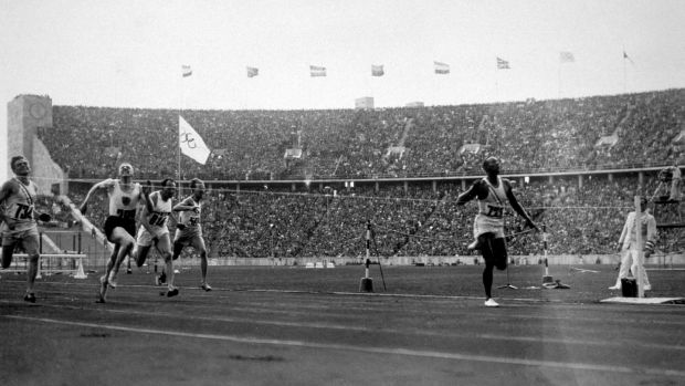 Owens crosses the finishing line to win the 100 metres in 1936. Photo: Keystone/Getty Images
