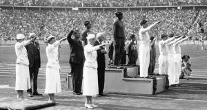 Jesse Owens at the medal presentation during the 1936 Olympics in Berlin. Photo: Getty Images