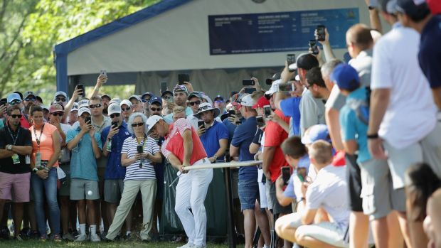 Woodland plays his second shot on the 18th during round two. Photo: Richard Heathcote/Getty Images