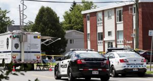 Canadian police investigate the apartment complex which was the scene of a shooting incident in Fredericton, New Brunswick. Photograph: Dan Culberson/Reuters
