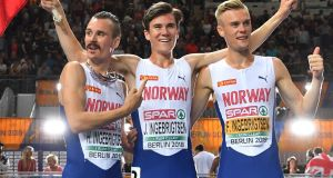 Norway's Henrik Ingebrigtsen, Jakob Ingebrigtsen and Filip Ingebrigtsen celebrate after the men's 1500m final race during the European Athletics Championships at the Olympic stadium in Berlin. Photo: Andrej Isakovic/Getty Images