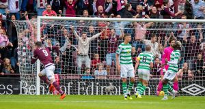 Hearts' Kyle Lafferty scores against Celtic at Tynecastle Stadium. Photograph: PA