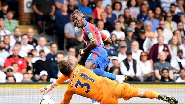 Wilfried Zaha of Crystal Palace scores his team's second goal past Fulham goalkeeper Fabricio Agosto Ramirez during the Premier League match at Craven Cottage. Photograph: Justin Setterfield/Getty Images