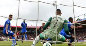 Bournemouth's Ryan Fraser puts the ball through the legs of Cardiff goalkeeper Neil Etheridge  during the Premier League match  at Vitality Stadium. Photograph:  Dan Mullan/Getty Images