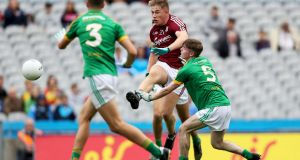 Galway's Oisín McCormack scores a goal during the  All-Ireland MFC semi-final against Meath at  Croke Park. Photograph: Tommy Dickson/Inpho