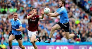 Dublin's Jack McCaffrey gets to the bounce of the ball ahead of Galway's Johnny Heaney during  the All-Ireland SFC semi-final at Croke Park. Photograph: Ryan Byrne/Inpho