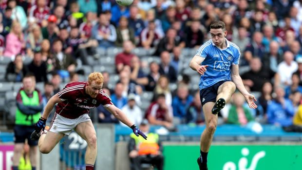 Dublin's Brian Fenton scores a point as Declan Kyne of Galway fails to get a block in during the All-Ireland SFC semi-final at Croke Park. Photograph: Laszlo Geczo/Inpho
