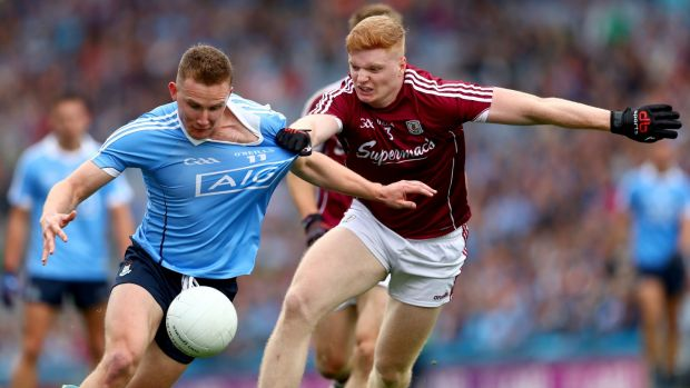 Dublin's Ciarán Kilkenny is held by Galway's Seán Andy Ó Ceallaigh during the All-Ireland SFC semi-final at Croke Park. Photograph: James Crombie/Inpho