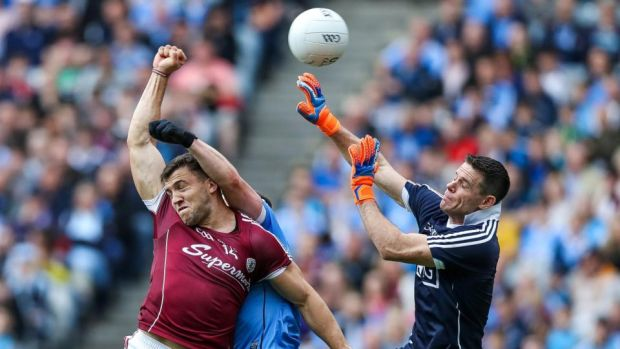 Galway's Damien Comer scores a goal under pressure from Stephen Cluxton of Dublin. Photograph: Tommy Dickson/Inpho